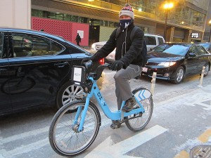 Divvy rider in the Dearborn protected lanes. Photo: John Greenfield
