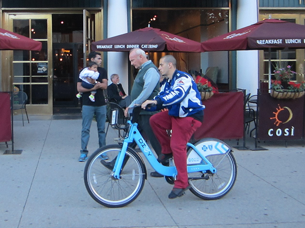 Detroit native Junior Bashi rides a Divvy on a A Michigan Avenue sidewalk. Photo: John Greenfield