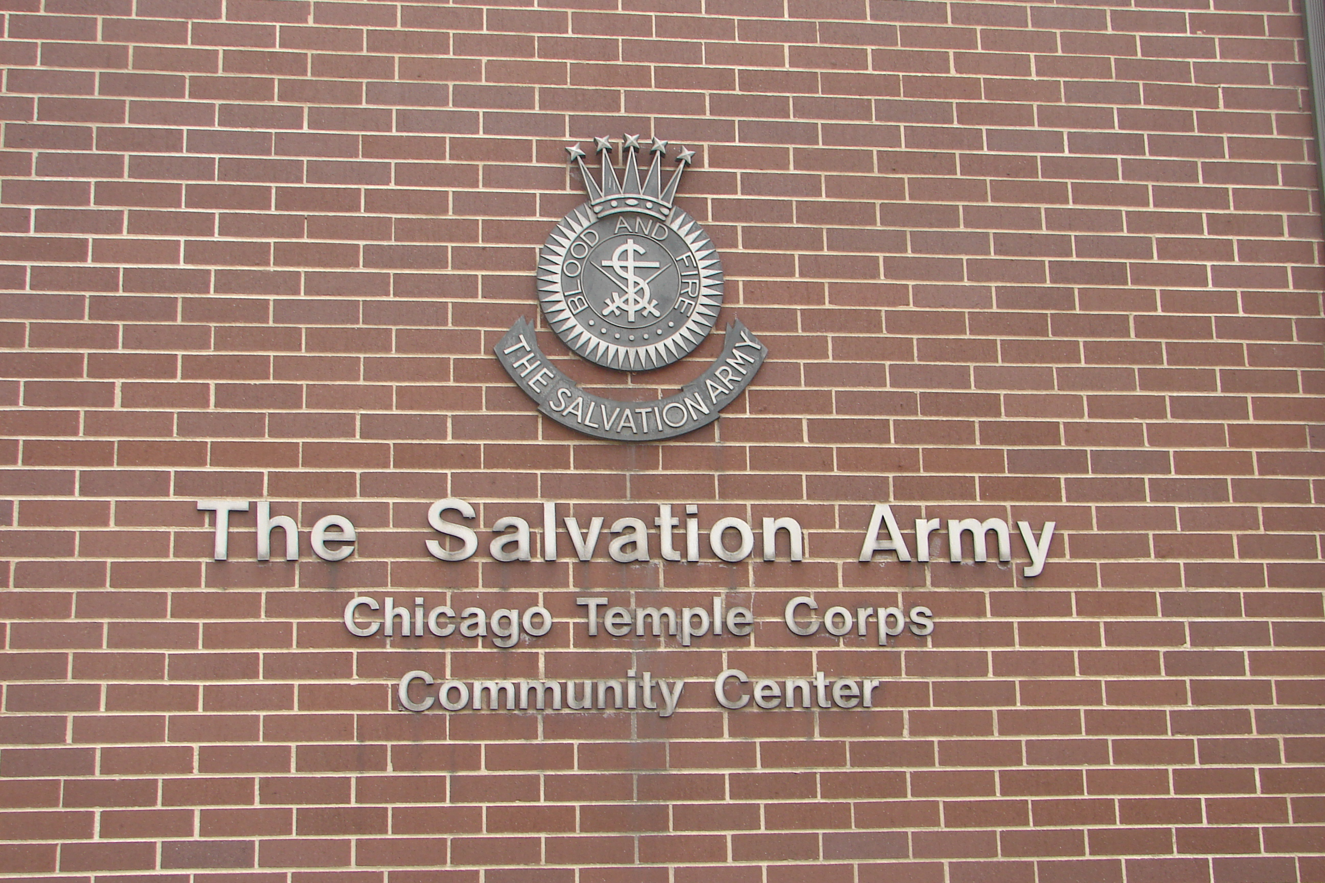 The Salvation Army sign on side of brick wall