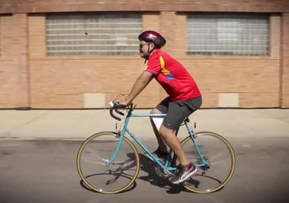García rides his bike in Little Village. Still from a campaign video.