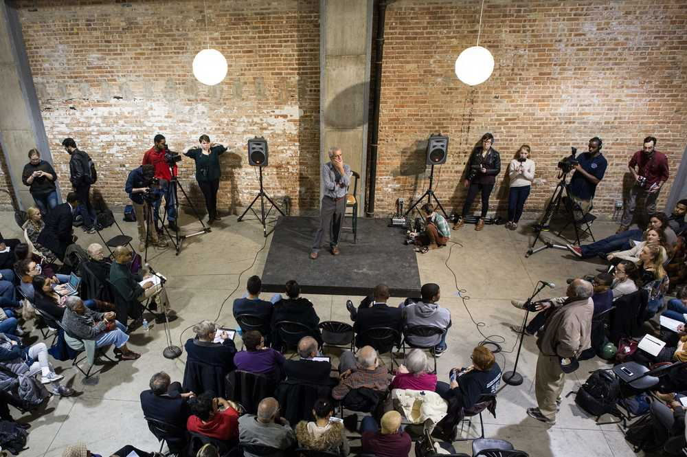 Justice activist Jamie Kalven is the center of attention at an Invisible Institute event Image/Photo: Patricia Evans